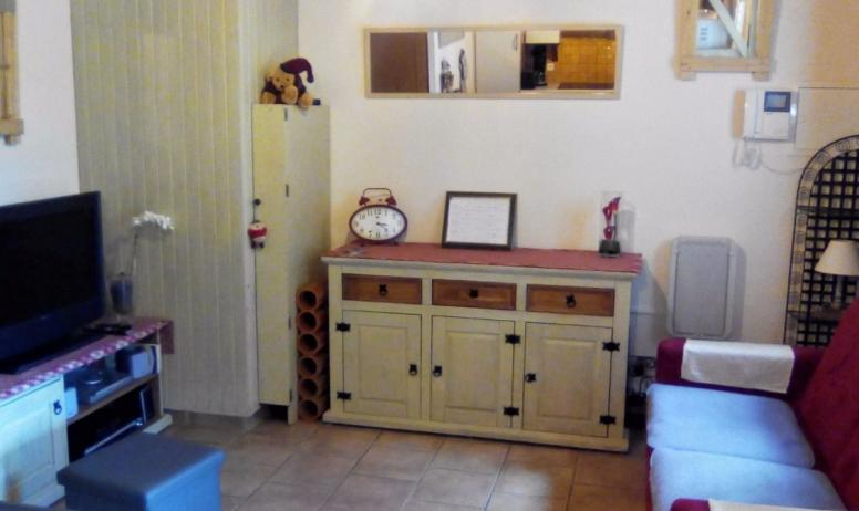 Clévacances - Coin salon avec canapé lit